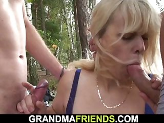 two buddy fuck old blonde granny on the beach